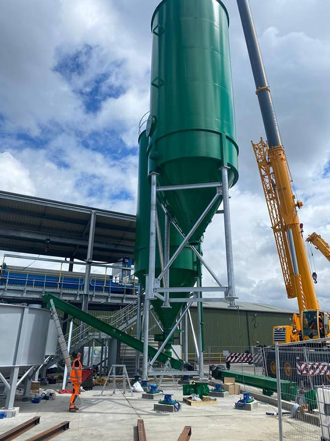 Carbon steel storage silos and carbon steel screw conveyors