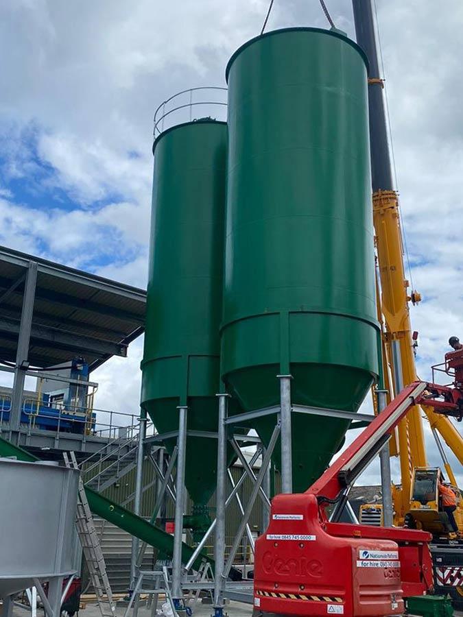 Two Carbon steel storage silos